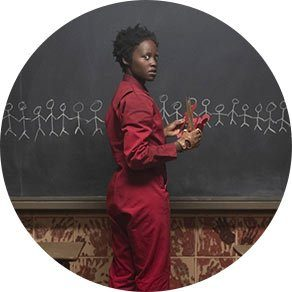Adelaide Wilson (played by Lupita Nyong'o) in a red jumpsuit